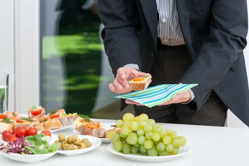 Business lunch and businessman holding colorful snack